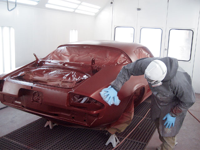 After the application of basecoat, the surface is given a wipe-down with an opened, fluffed, and loosely folded tack cloth. Base contains all of the color, but none of the gloss of the final paint finish.