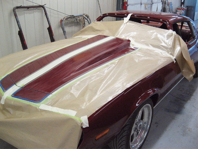 Once all of the panels were cut, buffed, and reassembled to the car, the stripe scheme was laid out and shot in Bronze Mist base (GM code 76, a '99 Chevy truck color) under an Ultra 7000 matte finish clear.