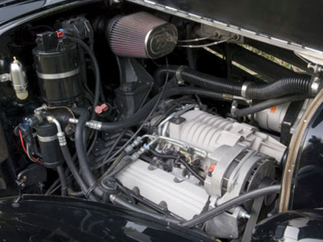 Normally found sitting sideways, the blown Pontiac V-6 provides plenty of power. note the position of the k&n air filter; it connects to the eFi's throttle body via a passage built into the firewall.
