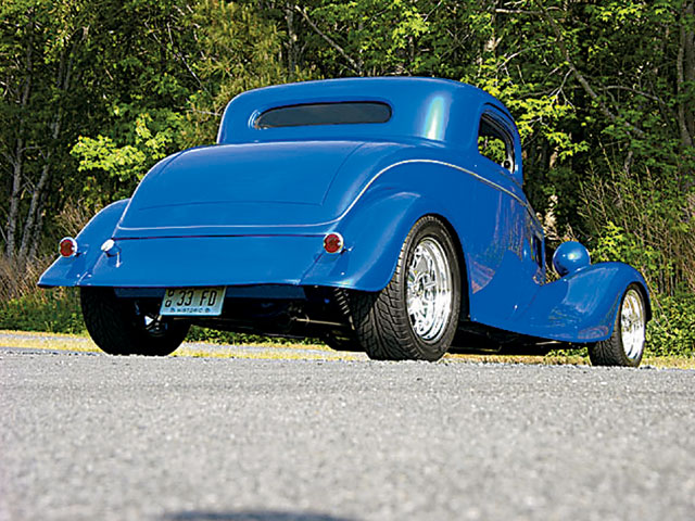 Low look, great stance, and Billet Specialties wheels make this 'glass coupe look the part of all hot rod.