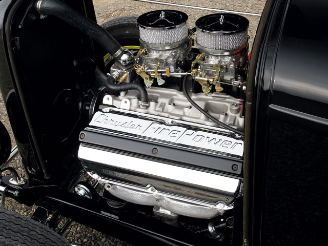 John tells us this engine is stock, and in the sense that he hasn't rebuilt it, he's right. Then again, it isn't, either; it has a hot heads induction and cam, and to install the latter he had to have the exhaust valve spring pockets machined to take Pontiac springs.