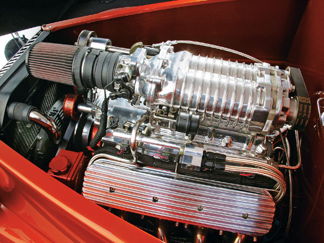 A GM Ls1 crate motor replaced the sleepy six-cylinder that previously resided under the sedan's hood. a MagnaCharger blower provides the go, while the polished intake and valve covers offer plenty of show.