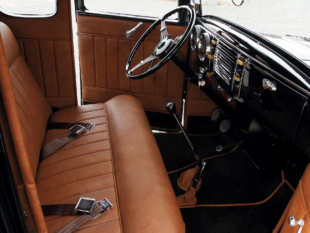 While that's a Glide seat in there, Jamie rice crafted everything else in the cockpit. The pleat pattern, the way Jamie bound the carpet in the seat material, and even the material choice to a degree suggest an old job; the only thing that really belies it: the s-10 stick.