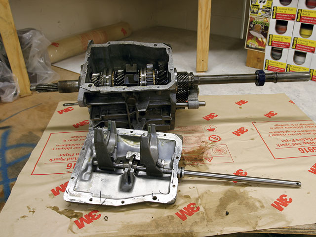 With the tailshaft assembly free, it can be slid off the output shaft and the case cover can be removed, exposing the transmission internals.