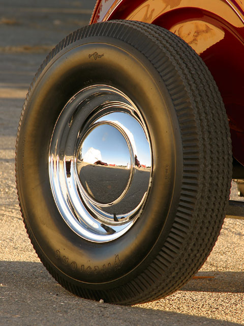 Chrome wheels in the '40s were a considerable achievement in cost alone. These are extra special at that;  the frontsare prized 4-inch-wide '40-only Fords and the rears are 5-inch-wide '39-41 lincolns- veritable holy Grails at this point.