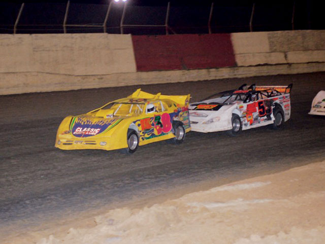 Crate late models like these of Chip Brindle (#38) and David Gentry (#56) racing in the Stormpay.com series deliver close racing action. Mike Blevins