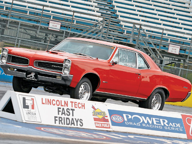 Floyd Hand's '66 Tempest runs a 0.030 over 10:1 compression 455 and ported (248 cfm) 7K3 iron heads to the tune of 11.50s at 117 mph on a 1.57 60-ft. The engine features a 950 cfm carb, Performer RPM intake, 234/244-deg Bullet cam, Hooker 1.75-in primary headers, 3-in x-type crossover and tailpipes from Pypes, and 2.5-in Straightline Performance mufflers. It's also equipped with a Turbo 400 automatic transmission, a Continental/Jim Hand 10-in 3,200-rpm stall converter, and an 8.5-in Corporate 10-bolt with 3.42 gears.