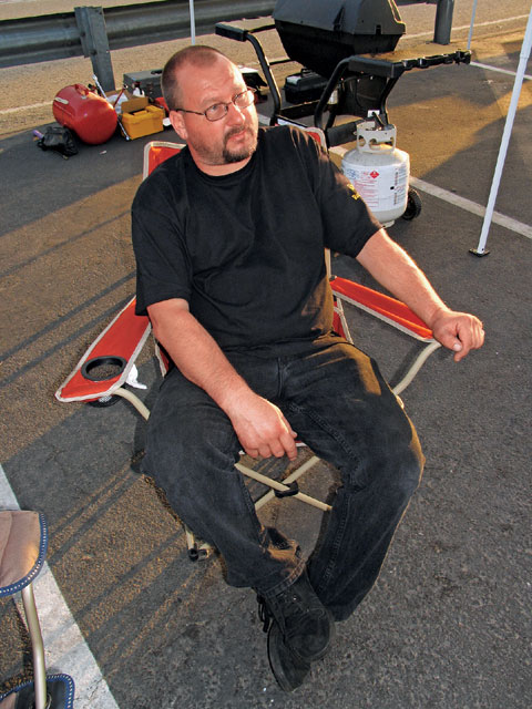 If you've done everything right leading up to race day, you can sit back and relax when you're at the track. Here's our engine builder, Andy Mitchell of Outlaw Racing engines (Upland, CA), taking a break on the day of the True Street competition.