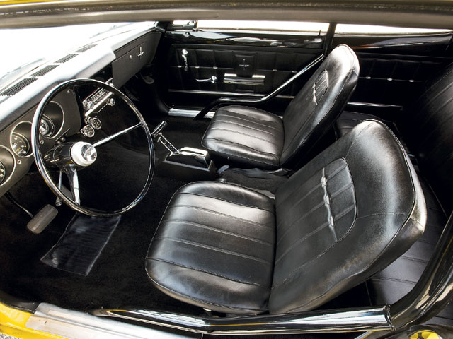 Although it's mint, the interior is all original and hasn't been restored. As the story goes, the Corvair was wrecked in the front and back in 1969, and parked in a barn until Larry's dad bought it over 30 years later. An aftermarket tach blends seamlessly into the gauge cluster in place of the factory clock.