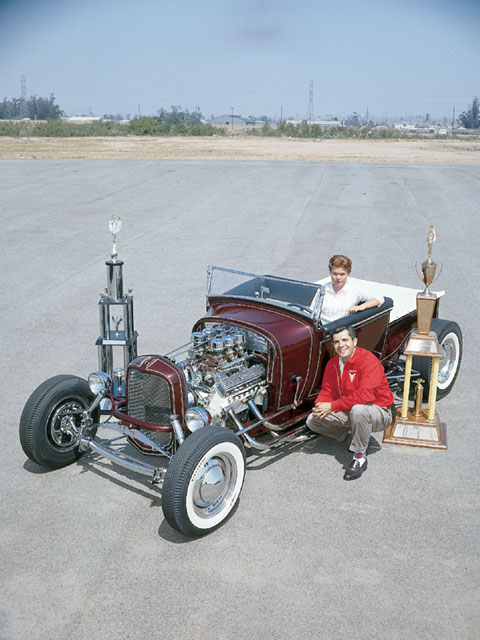 Here's one of the outtakes of the cover inset for the May '62 hot rod issue. in the car is susie, and beside it is Ed; flanking it are the hot rod of the year trophy from the '60 grand national roadster show and the sweepstakes trophy from the '62 nhra Winternationals.
