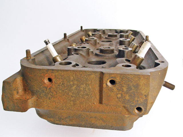 What makes the Hemi head (above) flow so well are the splayed valve angles, which reduce the sharp turns as the ports enter the chamber. Even the poly engine (below) still has some angle on the intake valves. Most wedge motors have valves almost straight up and down versus the block deck.