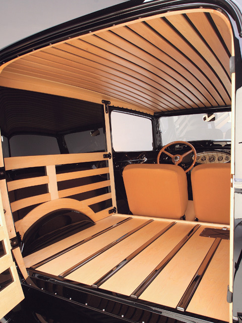 Kelly Page crafted the hard maple for this cargo area with furniture-grade joinery. Instead of cladding it in hardboard as Ford did, Dave created steel filler panels that fit behind the maple boards. The slatted roof hangs from the original top bows, and stainless strips sunk into rabbets in the floor prevent cargo from directly contacting the wood.