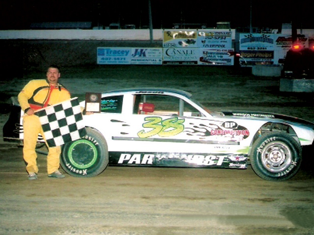 The winning built engine in Gary Parkhurst's car is now obsolete in his division because of a sanction rule change to a crate motor. Courtesy of D&B Photo