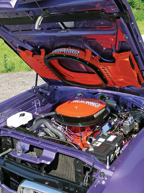 Bolt-on Power. Optional Ramcharger cold-air system added the orange underhood hardware, and additional power when opened up.