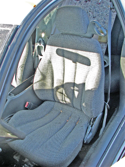 These seats from a Sunfire needed to be cleaned, but fit when bolted onto the Third-Gen seat mounts. Other seat donors include Sunbirds, Fieros, and Fourth-Gen F-bodies. To clean stains, rent a carpet steam cleaner with an upholstery tool at your supermarket, then spray 3M Scotchguard on the seats after they dry.