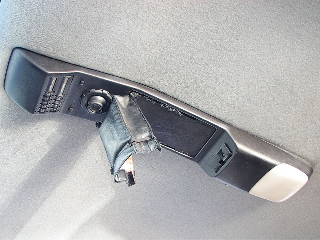 The overhead console has a built-in flashlight, although this one's map pocket has been torn down. This feature was available in coupe or T-top versions, which do not interchange. To remove it, take out the screws under the dome light lens and slide the entire console backward. Make sure to get the wiring and mounting screws. You'll have to cut your headliner to put it in.