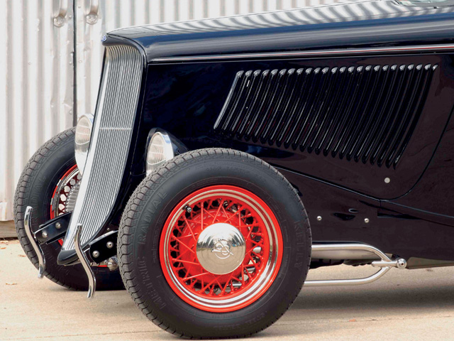 The coupe rides on Cooper 165R/15s wrapped around a pair of Wheel Vintiques 15x6 wires up front, with 305/60x17 Coopers around 17x10 Wheel Vintiques wires out back.