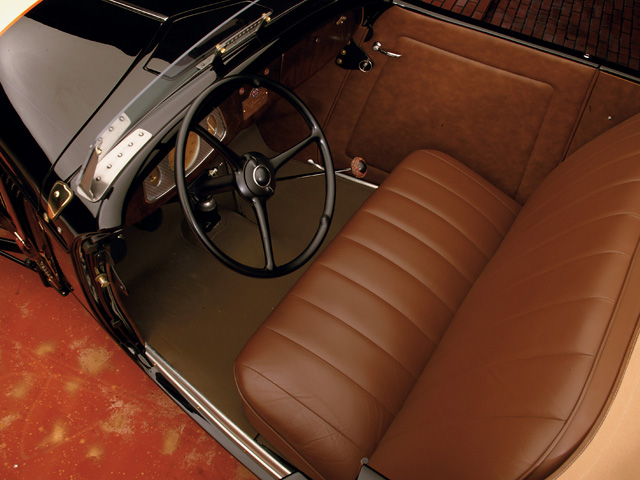 The stock-appearing interior is a leather LeBaron Bonney kit positioned by Don Small.