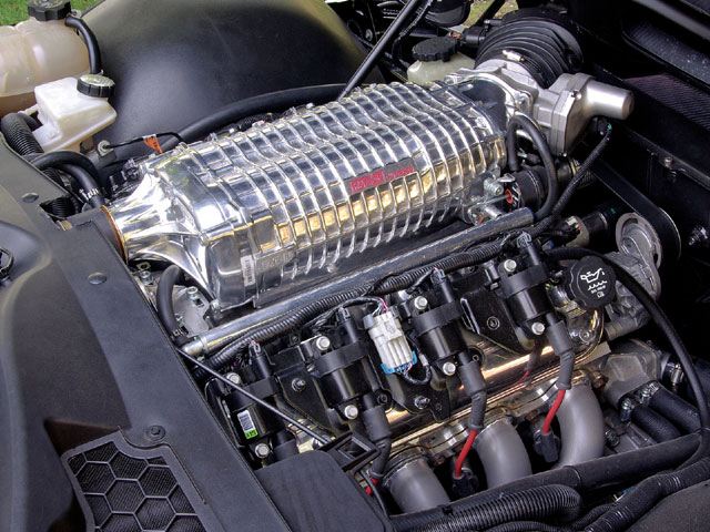 The 428 ci LSX V-8 is bolstered with a custom Harrop Engineering supercharger using a 2,300cc Eaton unit and a custom air-to-liquid intercooler system built into the intake manifold.