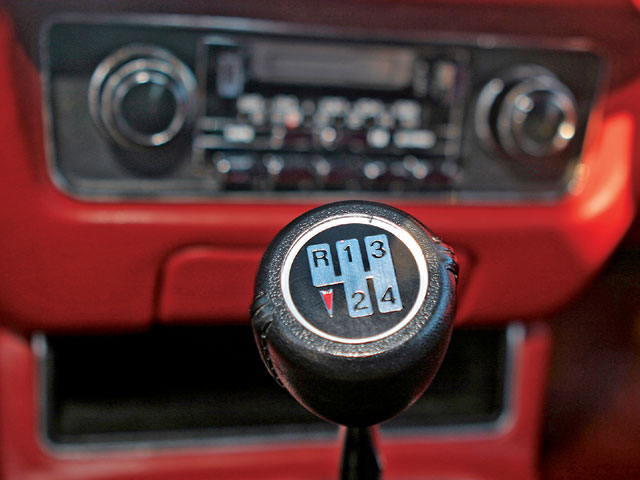 An immaculate four-speed shift knob just makes one want to hop in and row the gears in the Borg-Warner box. It takes a strong-willed owner to resist such temptations!