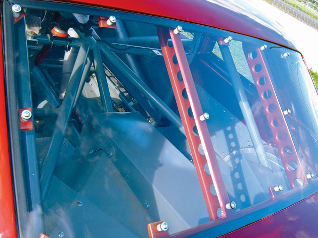 The rear window is 1/8-inch polycarbonate Lexan made by Shields and supported by sheetmetal braces. The bars inside are triangulated in the rear section for structural rigidity. Most of the bars are located below the centerline of the vehicle.