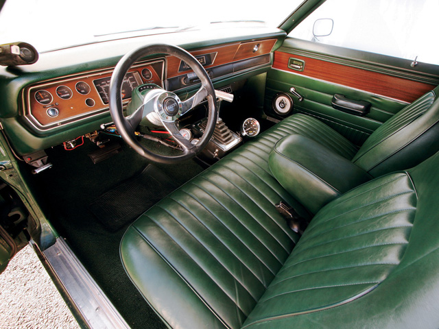 Inside, the Dart is stock down to its bench seats and lap belts. The car's low-key overall appearance helps it sneak by tech inspectors that somehow miss the motor's healthy lope. The only aftermarket parts are a Grant steering wheel, a B&M shifter, and an Auto Meter shift light and gauges.