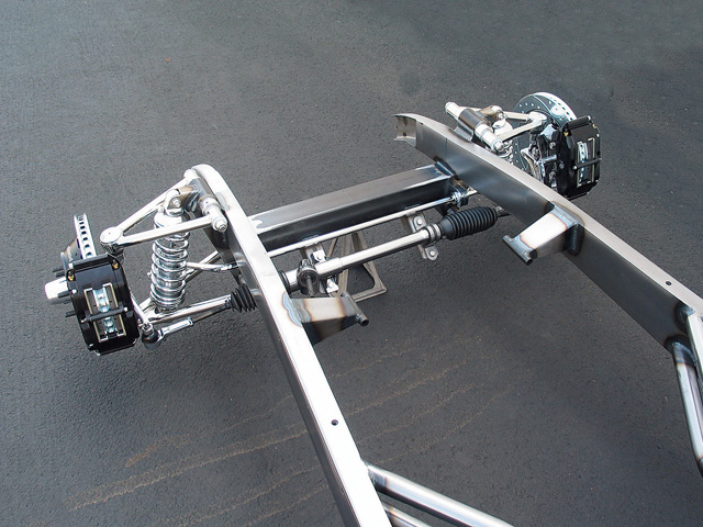 Here is a typical front suspension and steering system from a replica street rod. One of the advantages that kit cars have is that a modern front suspension is included and pre-engineered, so the owner will get great handling, precise steering, and modern brakes. This is much easier than cutting and welding in a system into an original chassis.