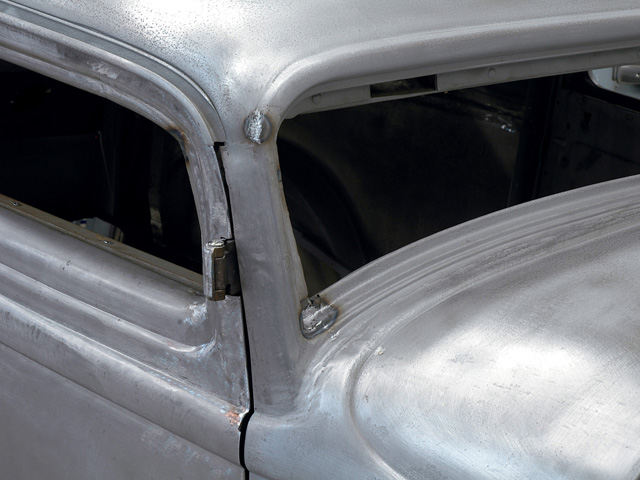 With the chop and final welding completed on the Deuce, there was still plenty of attention needed to get the A-pillar and cowl area back to perfection before it was ready for paint.
