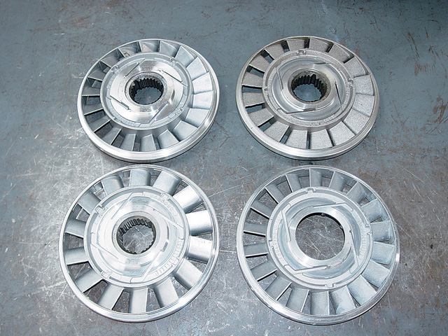 These are four different stators used in the 245mm converter to alter stall speed and torque multiplication. Note the differences in fin angle and window proportions. Dozens of different stall speeds can be achieved by using the right fin angle on the bowl and the right stator combination. Experience will allow the builder to select the right combination based on the particulars of your car and its intended use.