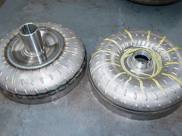 The converter on the left has an anti-balloon plate added, while the one on on the right has a stock-style cover. The plate helps the converter resist flexing and expansion in the thin hub area under extreme conditions. These plates come in various diameters and thicknesses depending on the application and are recommended for high-horsepower applications, especially with a power-adder like N.O.S. or forced induction. Phoenix uses antiballoon plates on all of its 245mm converters.