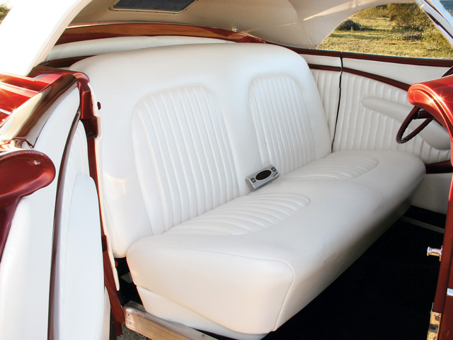 Pleated pearl-white leather is the perfect choice for this custom, and it was installed over the stock '36 bench seat and door panels by Contra Costa Vinyl. Haywire wiring was used throughout, and it also links the engine to the Classic Instruments gauges. The '40 Ford Deluxe steering wheel is both simple and appropriate for the look Rick was going for, and is colormatched to the car's exterior.