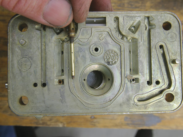 This is an emulsion tube found in most Holley carburetors. This tube sits in the main well and mixes the fuel with air from the air-bleed and adjacent air channel that eventually finds its way to the venturi booster.
