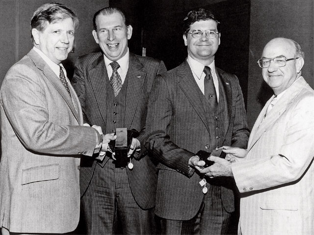This is the presentation of the GM Boss Kettering Award for the Pontiac 2.5L four-cylinder engine intake manifold design in 1979. From left are Bill Aldrich, Pontiac General Manager Bob Stempel, John, and Bob Decker.
