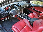 Inside, you're met with a welcoming environment. Plush, comfortable seats are covered in high-quality red leather and stitched with the GTO name. The gauge cluster matches the seats, has a red face, and tells the driver a glut of information.