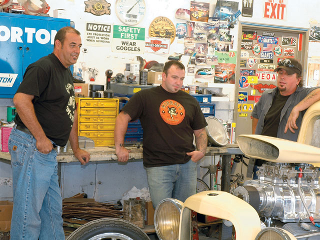 Just the guys hanging out on a Saturday afternoon discussing the truck's next step. From left to right, Ed Shyzmansky-who was nice enough to let us use his shop, Auto Body Unlimited, for the shoot-Ray Benson, and A Touch of Evil owner Bruce Comboni.