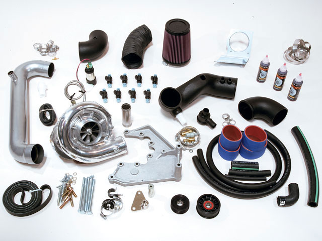 Everything you need comes in this kit: injectors, hose clamps, belt, plumbing, and the supercharger itself. The suggested retail price for the '03 Mustang GT kit tested here: $4,257.95 (PN 4FL218-138SQ). The street price from mail-order specialist Summit is $3,811.95.