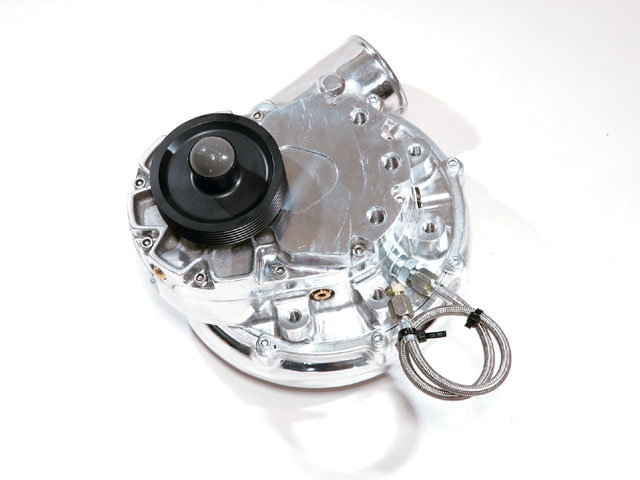 Many superchargers use an external oil feed line that requires the oil pan to be drilled and tapped for the return. This kit, however, features a self-contained oiling system that has a single line used as a drain.
