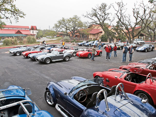 On Saturday, we all dined at the El Arroyo Mexican Restaurant, our first stopping point for our scenic drive around Austin. Dallas Cobra Club/TCC member Larry Reyburn owns the No. 15 FFR Type 65 coupe in the background. Red No. 22 is a Unique Motorcars 289FIA, which DCC/TCC member Jim Jacobs owns. John Russell has the hardtop-equipped, white-over-blue Superformance Cobra, No. 17, toward the back of the photo.