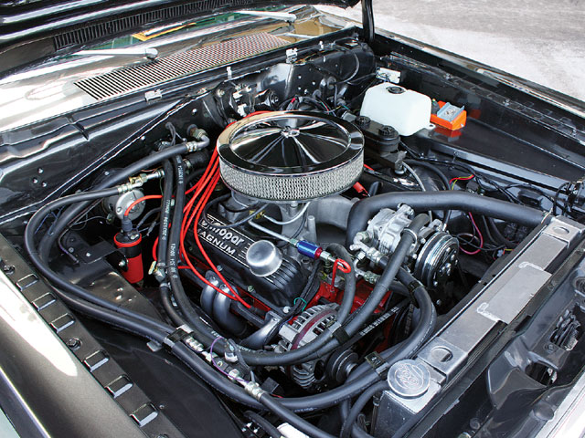 The rear placement of the battery cleans up the engine bay so you can clearly see the Mopar Performance crate engine.