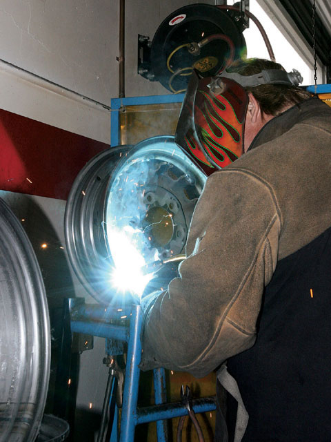 Once satisfied the wheel is round, Chris Sage tack welds the center in place. The wheel is then again checked for trueness-only then does the final welding take place. It is then checked a third time for trueness.