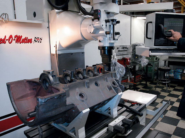 Speed-O-Motive uses Rottler CNC machines for just about every machining process. This speeds up the machining process incredibly by having all the specs pre-programmed into the machine's computer. Unfortunately, our extended bellhousing Hemi block was not one the company had done before, so a whole new program had to be written.