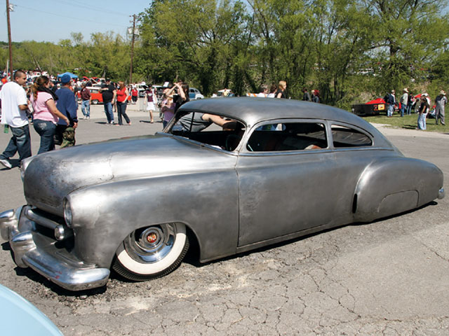 The chop, the reworked nose, the molded rear fenders, and the frenched lights all added to the overall coolness of Dudley Owens' '49 Chevy Fleetline.