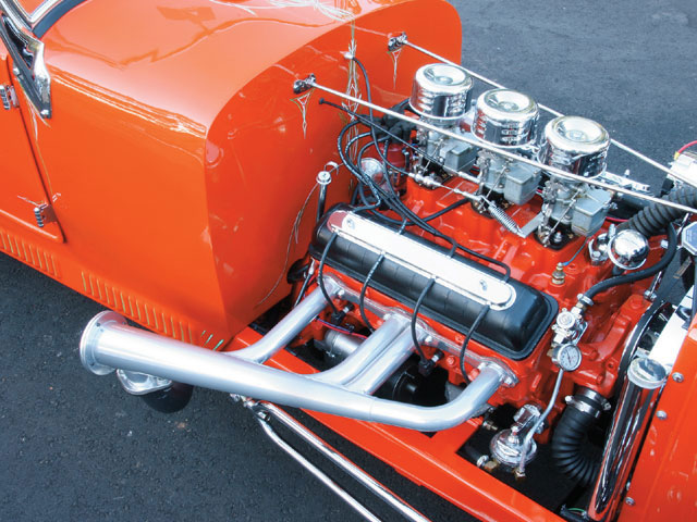 An Olds Rocket? Not quite. Ron added a set of Fauxsmobile valve covers to his 283 to make it look like the vintage Olds motor from 1949-50, and it fools nearly everyone who takes the quick glance at the engine. Bored 0.030 to 292 cubes, the Chevy is topped with a trio of Stromberg 97s and an Edelbrock manifold. Ron relied on Summit and Speedway Motors for many parts and pieces for his car, and he built the motor himself.