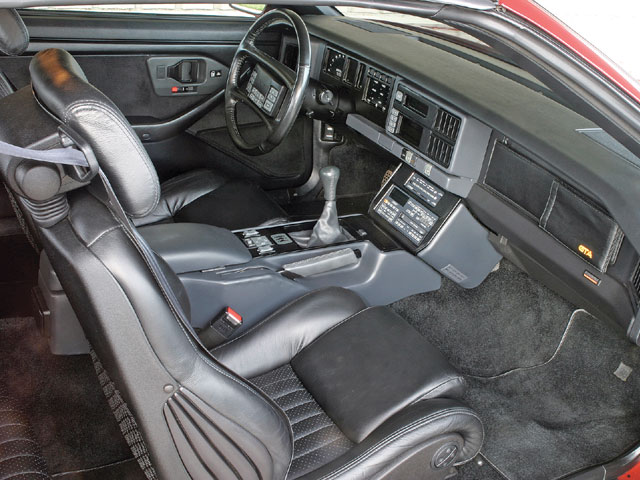 There aren't any changes that jump out at you when you open the doors to the notchback versus the regular GTA. Inside, you'll find no short list of creature comforts, putting the driver in-tune to his needs. The only noticeable addition to the interior is the new rear seat backs with incorporated headrests-also available on the '89 Turbo Trans Am.