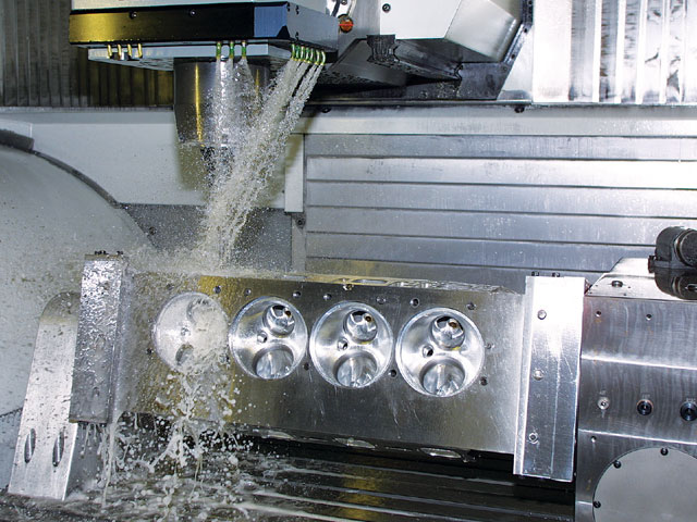 No matter what engine you're building, the right heads are paramount for power. Indy Cylinder Head's shop has the latest CNC machines to maintain consistency and accuracy in the machining process. Here, an Indy Legend Hemi cylinder head is being machined on one of Indys' 16 CNC machines.