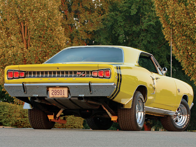 The first year for the optional bumblebee stripes on the Coronet R/T was 1968. Mike's earned its (repro) stripes after the body was smoothed out and painted Hi-Impact Citron Yella. Note the new-for-1968, Coke-bottle contour of the rear quarter just aft of the door.