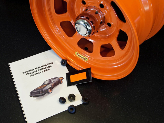 It's a pretty closely guarded secret, but Bassett Racing Wheels can build pretty much any 15-inch steel wheel in any custom width and offset. We also got ours custom powdercoated-the whole set (plus a fifth wheel for a spare) cost us $448 including a set of NASCAR-spec 1-inch lugnuts. Note the custom vinyl swatch we sent to help match the color.