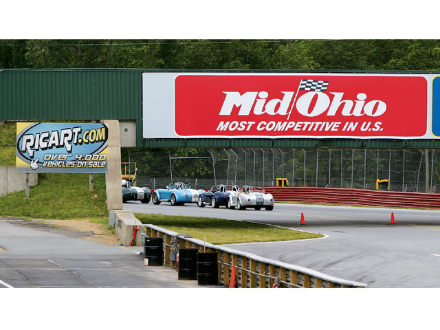 Cars in line under the Mid-Ohio bridge and sign embarked on another fun lead/follow session with Mid-Ohio's professional racing instructors.