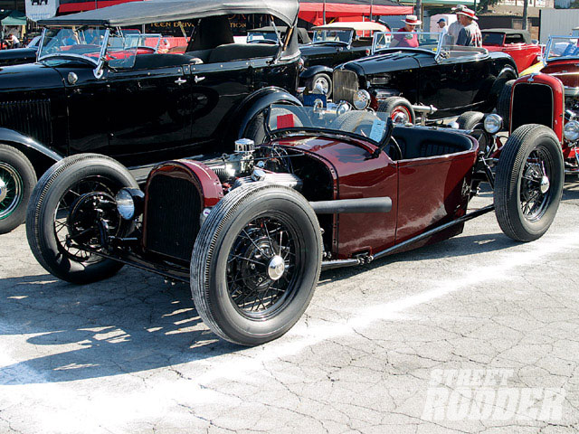 Modified roadsters are always cool, especially when they're as low-slung as this burgundy number.