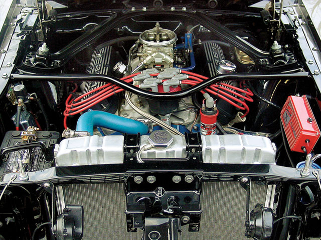 This Mustang left the factory with a 351W, and while the current engineis based on a Windsor block, it's actually pushing 408 cubes thanks toan Eagle stroker crank. Carrillo rods and JE pistons fill out theshort-block, making 10.4:1 compression with the Edelbrock Victor Jr.heads and intake. Best pass to date is an 11.63 at 117.8 mph.